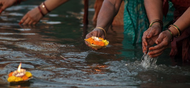 Women conducting puja ceremonies in river Ganges.